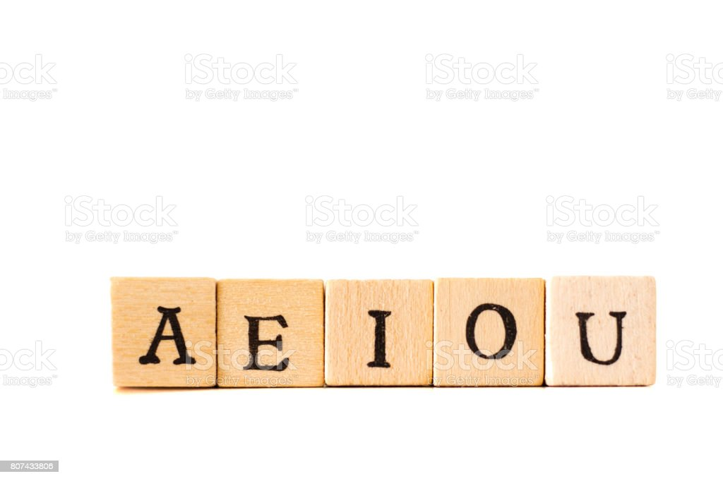 AEIOU: Vowels Written in Wood Block Letters, White Background stock photo