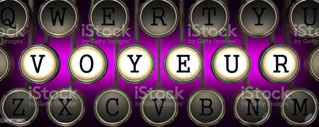 Voyeur on Old Typewriter's Keys. stock photo