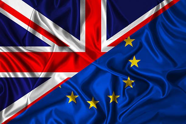UK vs EU -  flag on wind stock photo