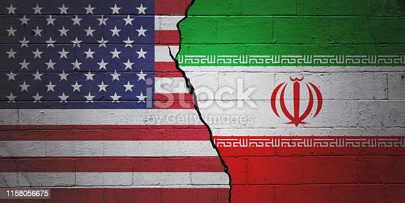 Cracked brick wall painted with an American flag on the left and a Iranian flag on the right.