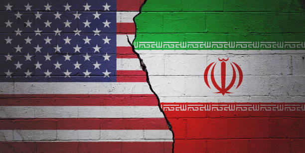 USA vs Iran Cracked brick wall painted with an American flag on the left and a Iranian flag on the right. iran stock pictures, royalty-free photos & images
