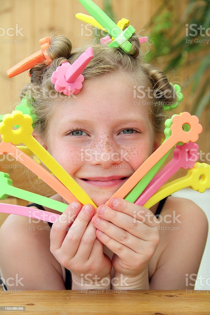 v-shaped curlers stock photo
