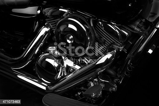 A close-up/high angle on a V-Twin motorcycle engin with a lot of chrome.  High contrast, artistic rendering.  Selective focus.