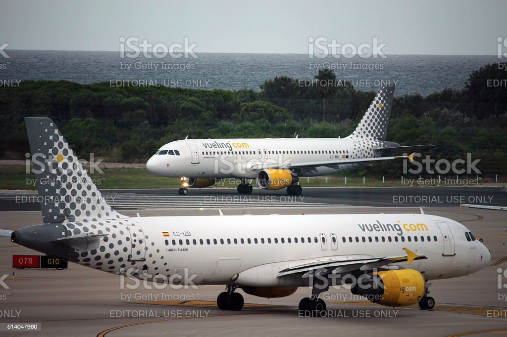 Vueling airbuses ready to take off stock photo