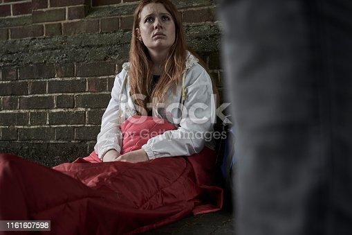 Vulnerable Homeless Teenage Girl Sleeping On The Street