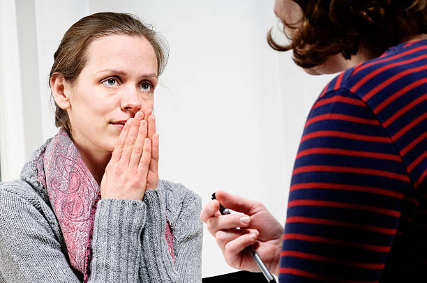 Vulnerable Young Woman Talking To a  Counsellor stock photo