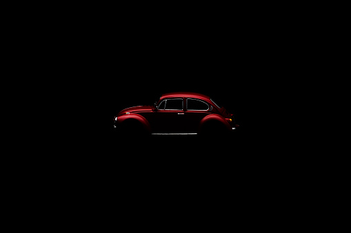 Sebes, Romania - november 06, 2014: Red toy Vw beetle isolated  on black background