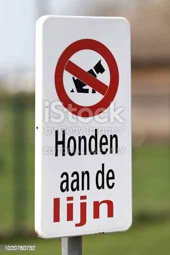 Amersfoort, Netherlands - April 17, 2018: Information sign that's forbidden to let dogs walk free. They should be on a line.