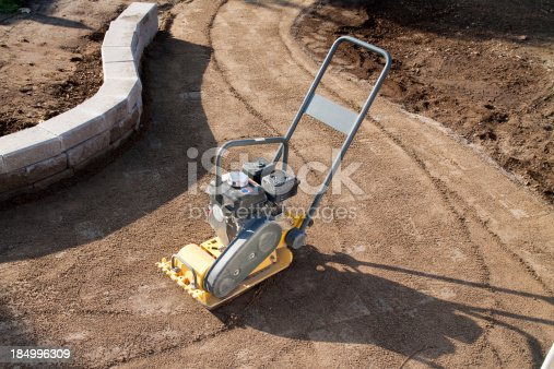 Interlock brick walkway cover with sand ready for compaction with the compactor.Rental unit side light with reflector.