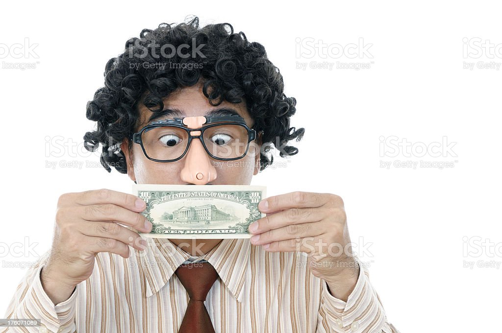 Wacky man holding and looking at currency royalty-free stock photo