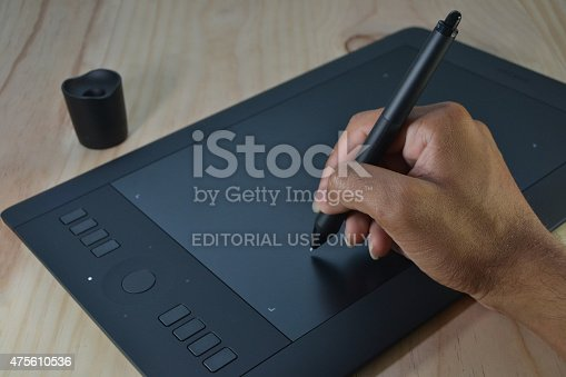 Port-Louis, Mauritius - May 21, 2015: User using Intuos pro graphic tablet, a product of Wacom a Japanese company headquartered in Kazo, Saitama, Japan, that specializes in graphics tablets and related products