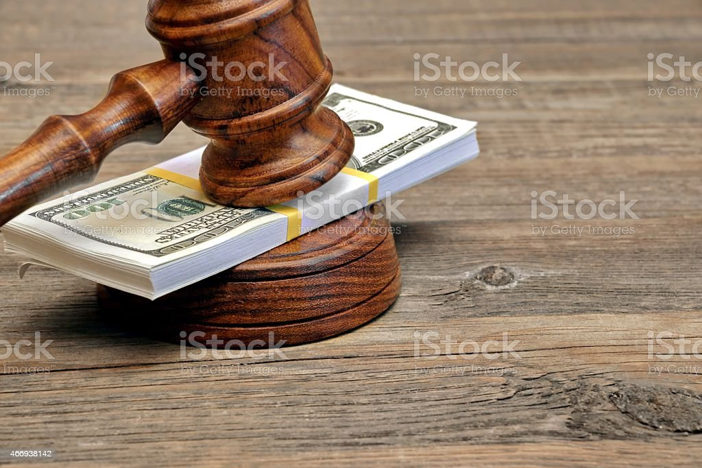 Wad of Money and Judges Gavel stock photo