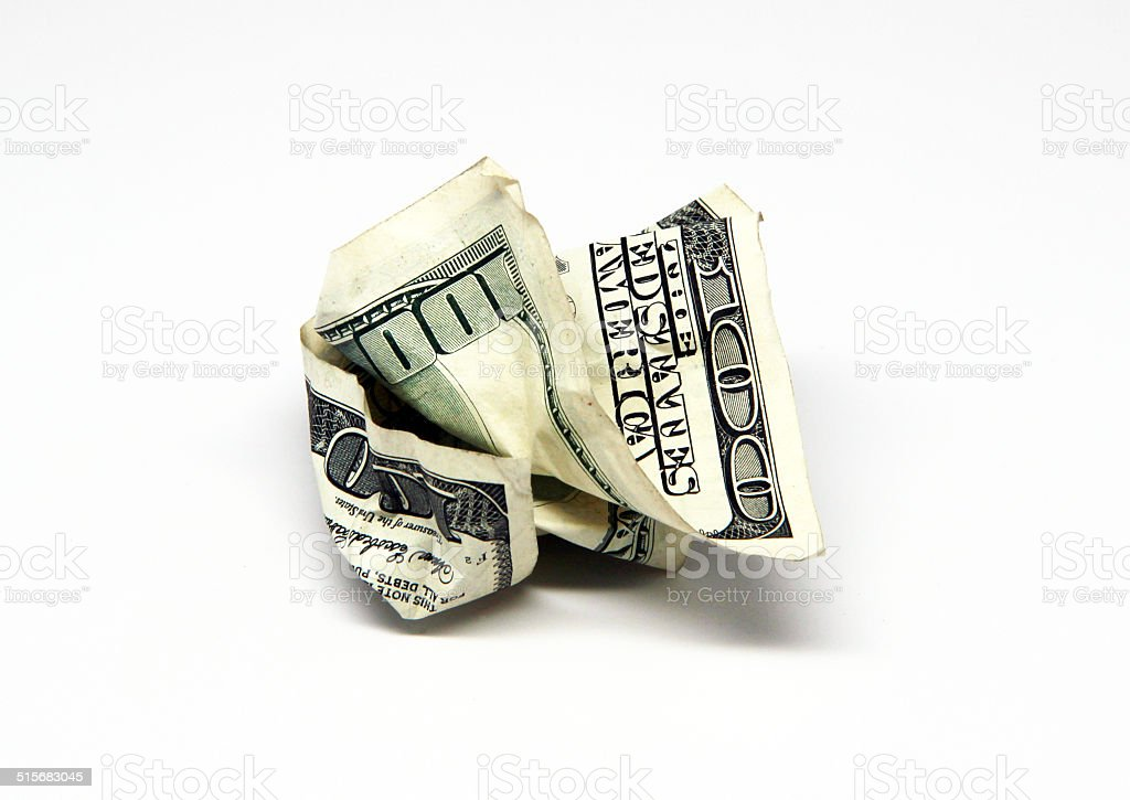 Wadded Up Hundred Dollar Bill stock photo
