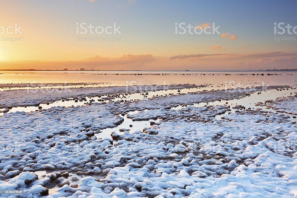 Wadden Sea coast, Groningen, The Netherlands at sunset in winter stock photo