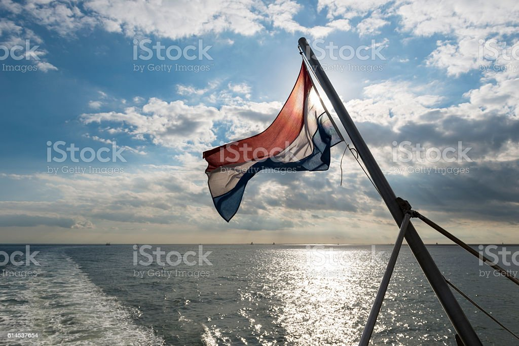 Wadden Sea with Dutch flag stock photo