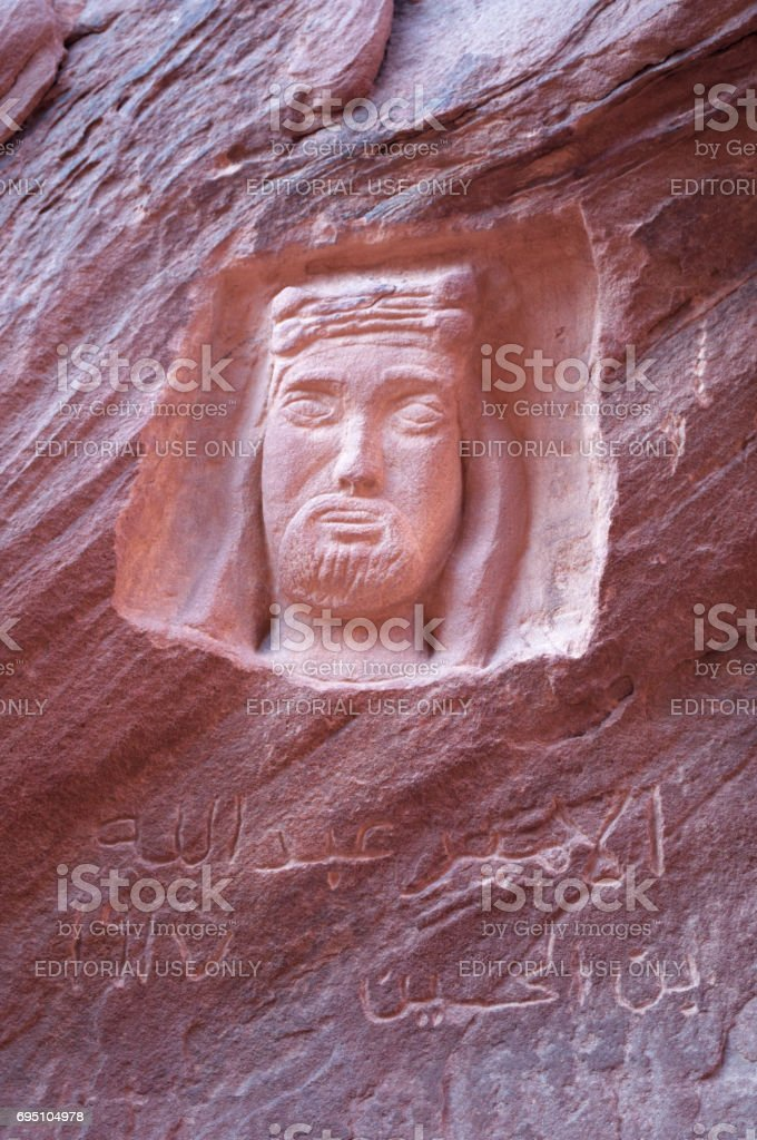 Wadi Rum: carving and inscription on the rock commemorating Lawrence of Arabia, the British officer and archaeologist T. E. Lawrence, in the desert of Wadi Rum, known as Valley of the Moon stock photo
