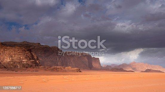 Wadi Rum desert and rocks under a stormy sky in Jordan