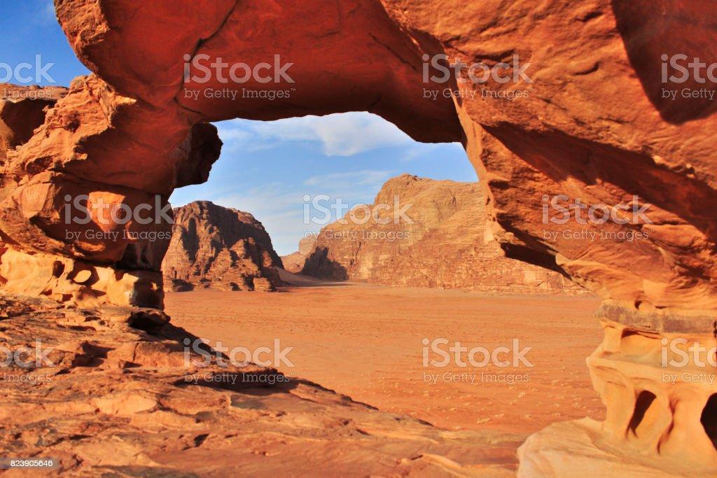 Wadi Rum red dessert in Jordan with Nomad's tent seen by rock window stock photo