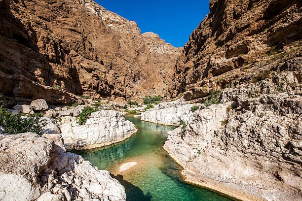 wadi shab, oman beautiful wadi shab, oman. riverbed stock pictures, royalty-free photos & images