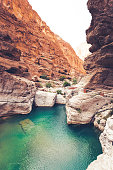beautiful wadi shab riverbed oasis at the sultanate of oman.