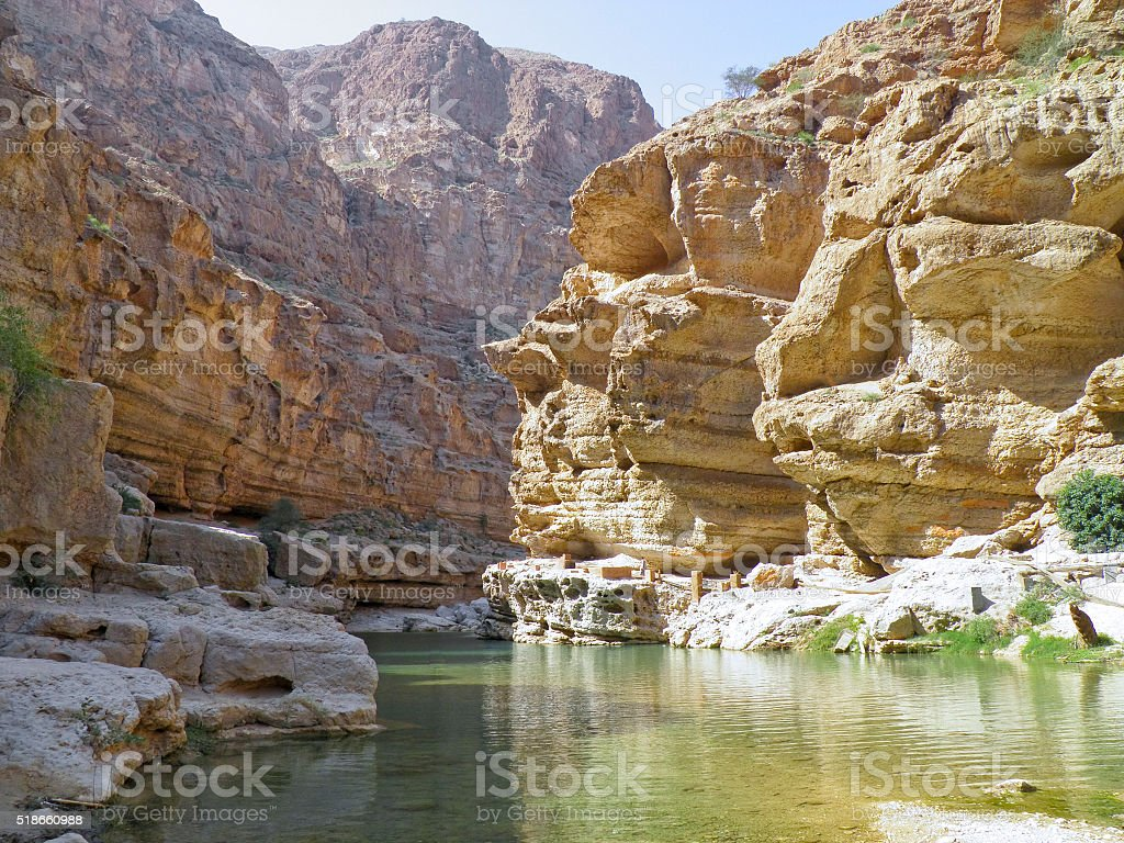 Wadi Shab with emerald green water stock photo