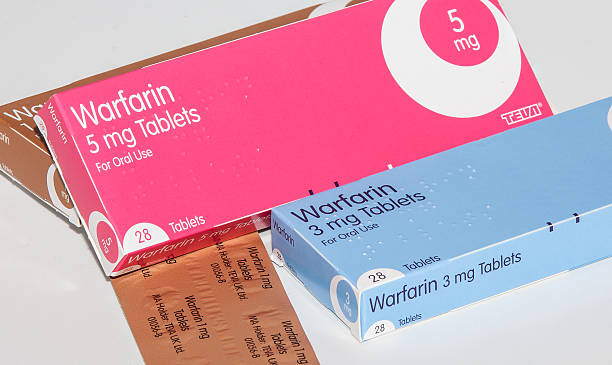 Wafarin Cleethorpes, England  - December 21, 2013: Cleethorpes, England - December 21, 2013: Boxes of anticoagulant drug warfarin on white background anticoagulant stock pictures, royalty-free photos & images