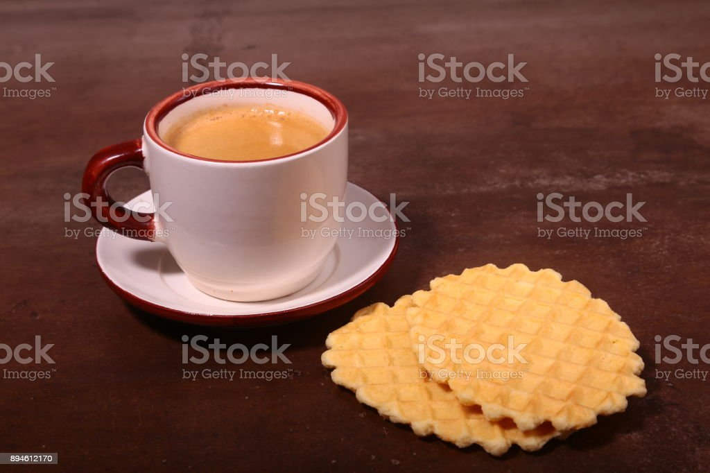 Wafel, caramel waffle and coffee cup, coffeebreak isolated on dark background stock photo
