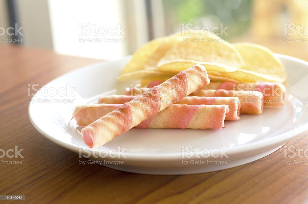 Wafer rolls and potato chips royalty-free stock photo