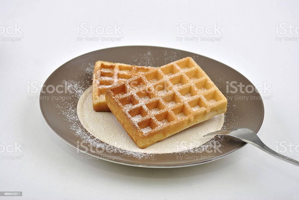wafer with icing sugar on a plate royalty-free stock photo
