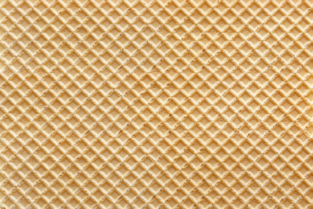 Wafer with vanilla background Wafer with vanilla background, full frame waffle stock pictures, royalty-free photos & images