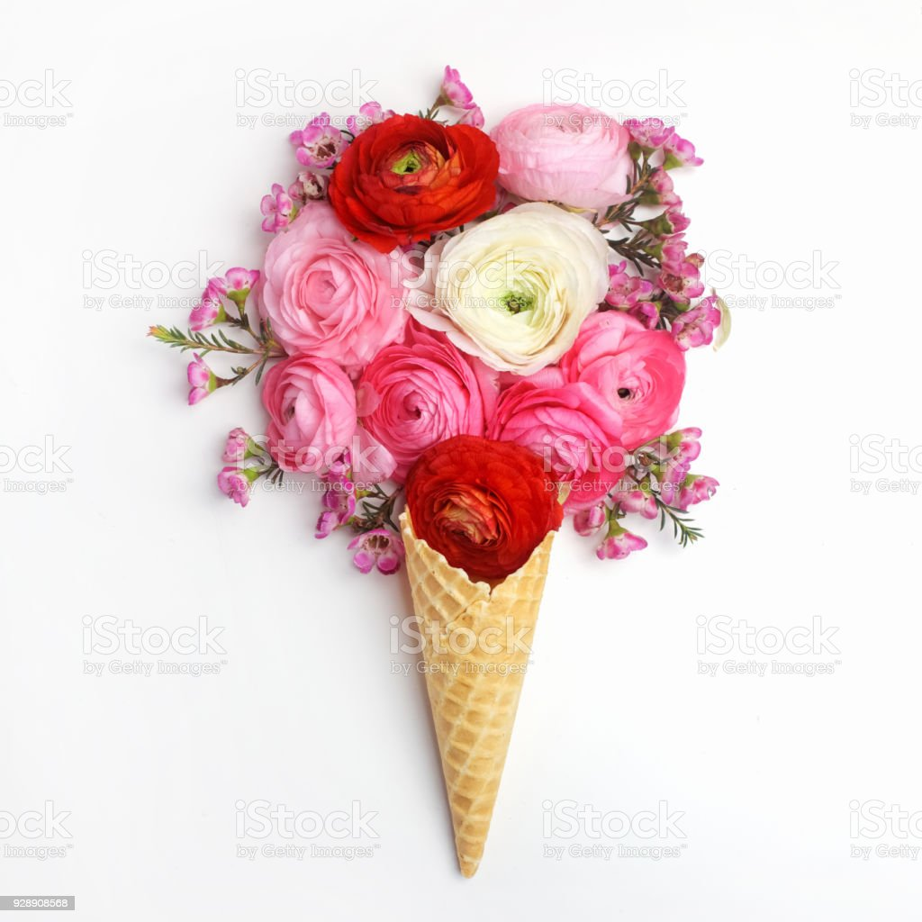 Waffle cone with composition of colorful flowers.Flat lay, top view