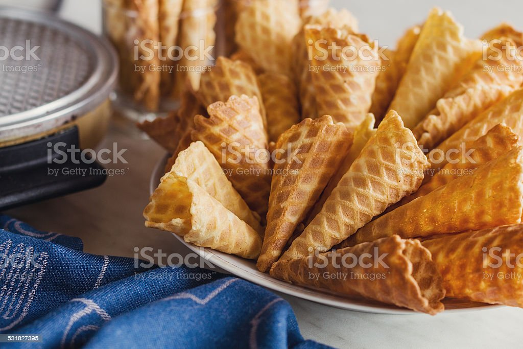 Waffle cones on plate. Top view stock photo