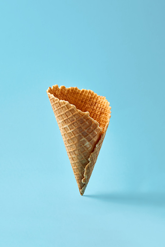 istock Waffle cornet on light blue background 930063470