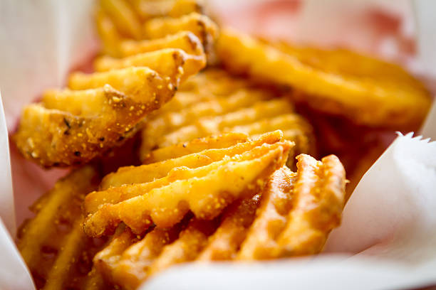 Waffle Fries Waffle Fries in Basket waffle stock pictures, royalty-free photos & images