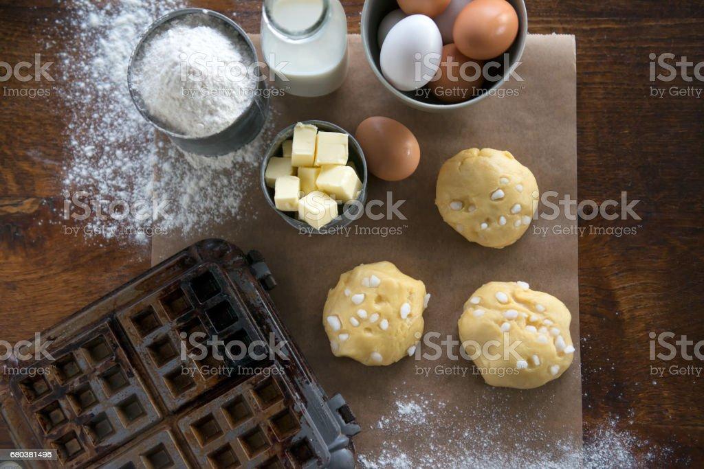 Waffle Iron, Dough, Flour, Milk, Eggs, Sugar, Butter, Parchment Paper stock photo