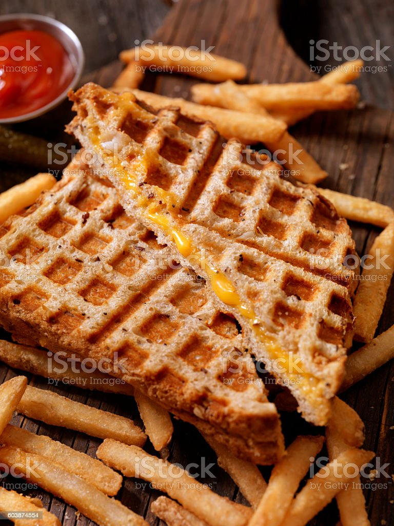 Waffle Iron Grilled Cheese Sandwich with Fries stock photo