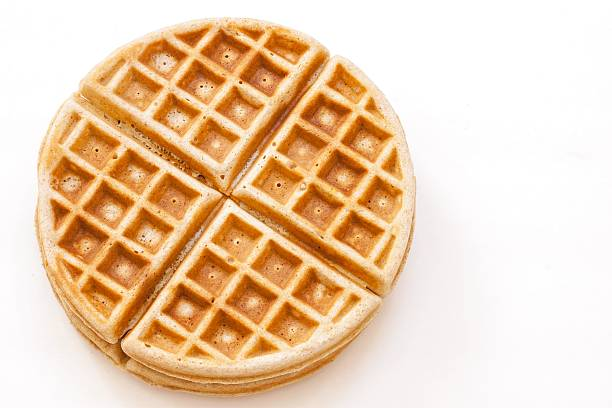 Waffle isolated on white Homemade whole wheat waffle isolated on white waffle stock pictures, royalty-free photos & images