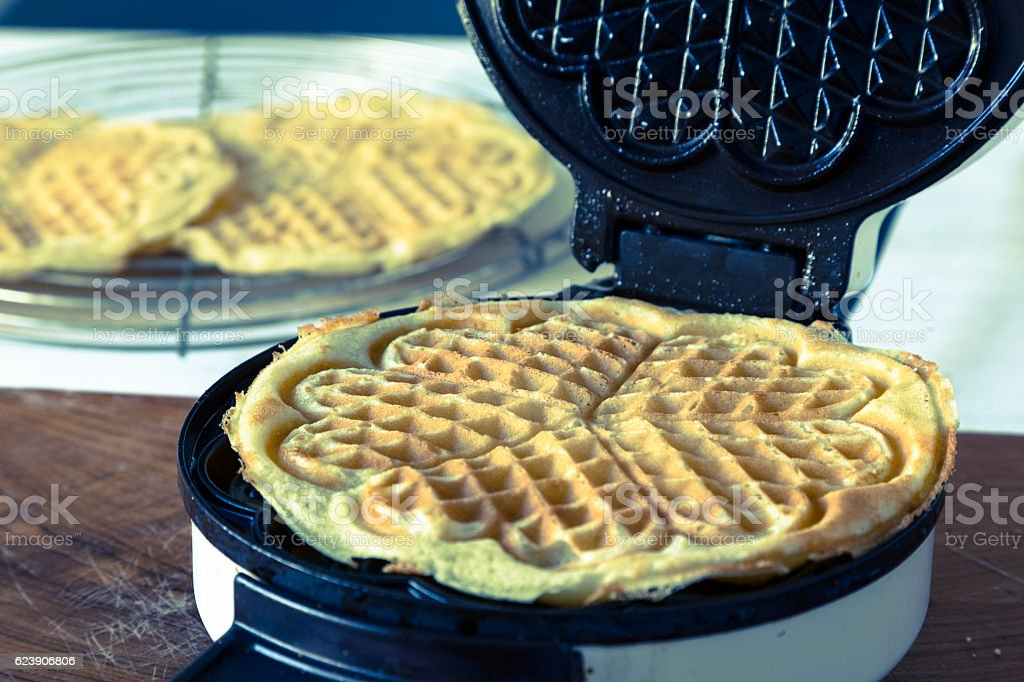 Waffle Makers in operation stock photo