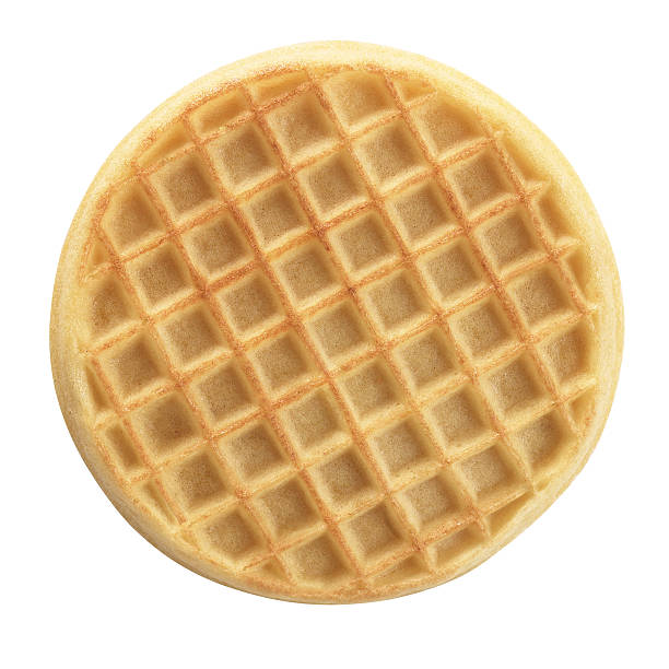 Waffle Round waffle viewed from above.  A clipping path is included. waffle stock pictures, royalty-free photos & images