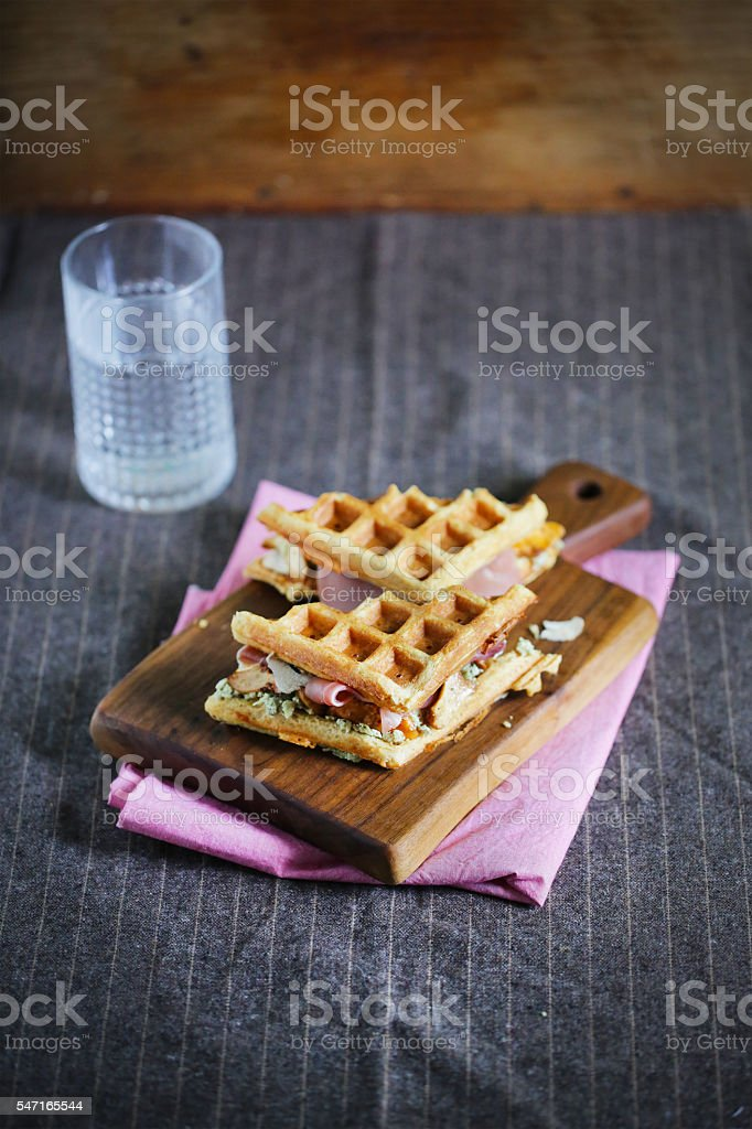 Waffle sandwich with prosciutto and cheese stock photo