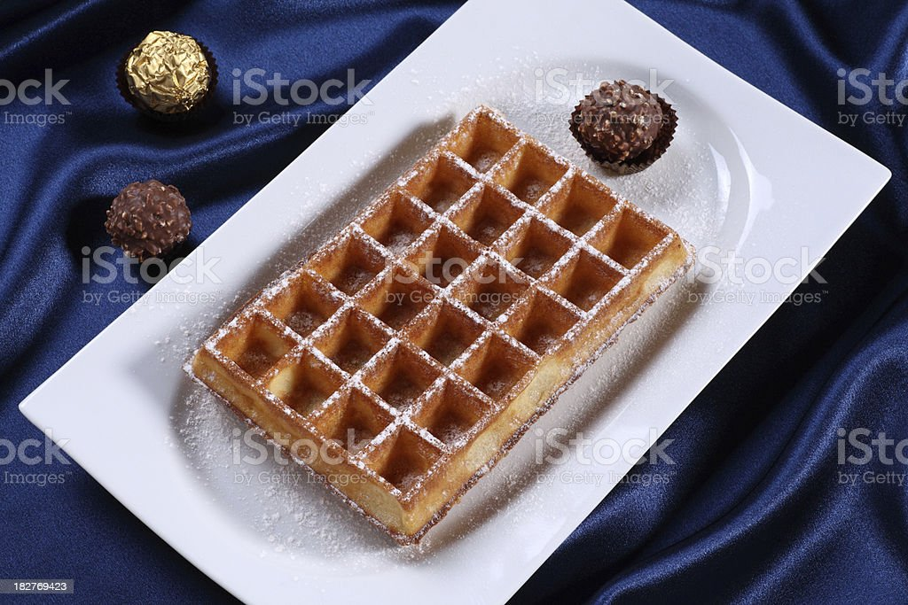 Waffle served with candies. stock photo
