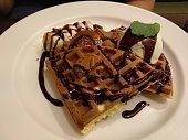 Waffle with chocolate sauce and ice cream