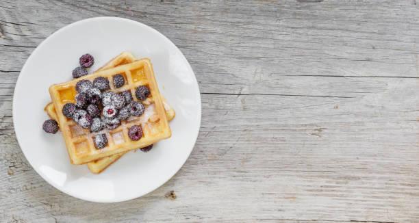 Waffles and fresh berries stock photo