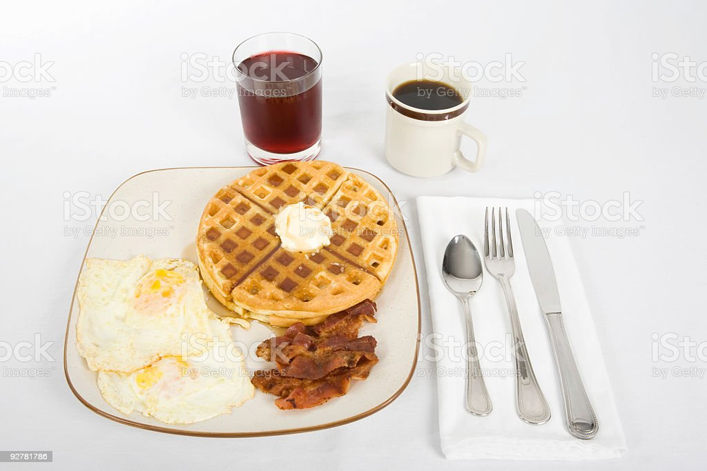 Waffles Eggs and Bacon for Breakfast royalty-free stock photo