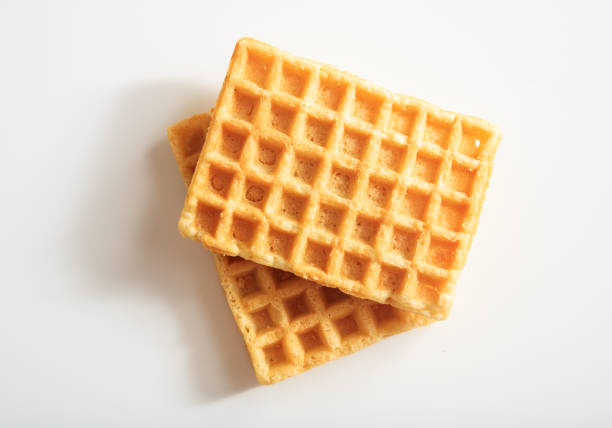Waffles on white background Two waffles on white background waffle stock pictures, royalty-free photos & images