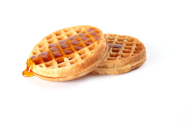 Waffles Waffles with maple syrup. waffle stock pictures, royalty-free photos & images