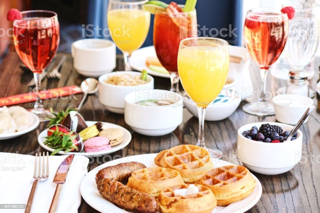 Waffles, sausage, and Mimosa Brunch stock photo