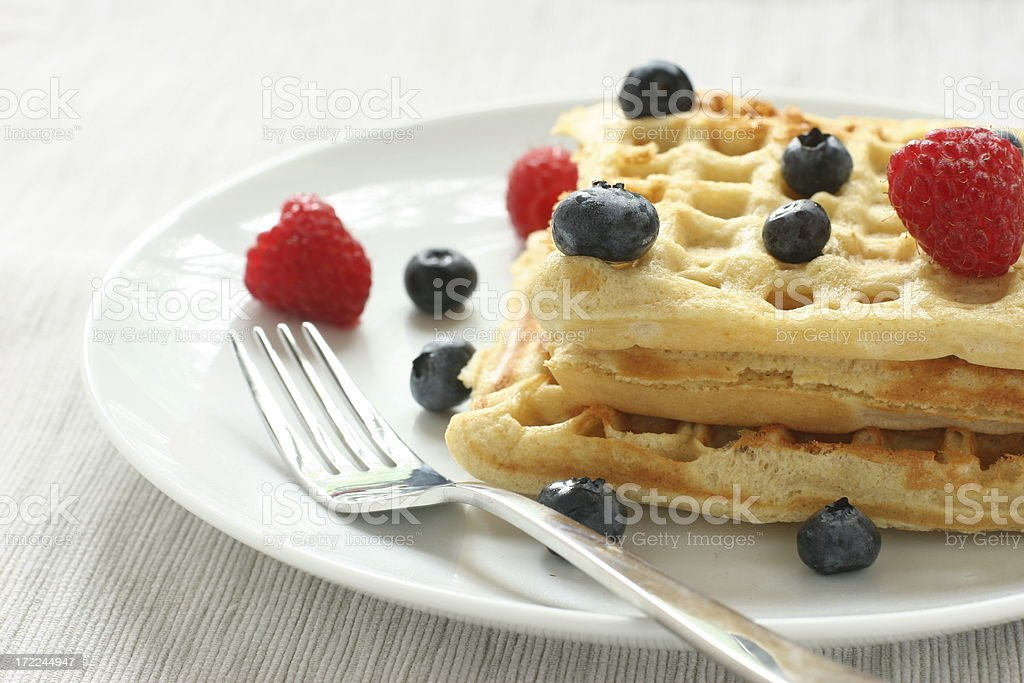 waffles with berries and fork royalty-free stock photo