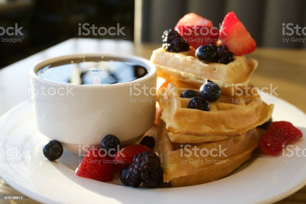 Waffles with Berries and Syrup stock photo