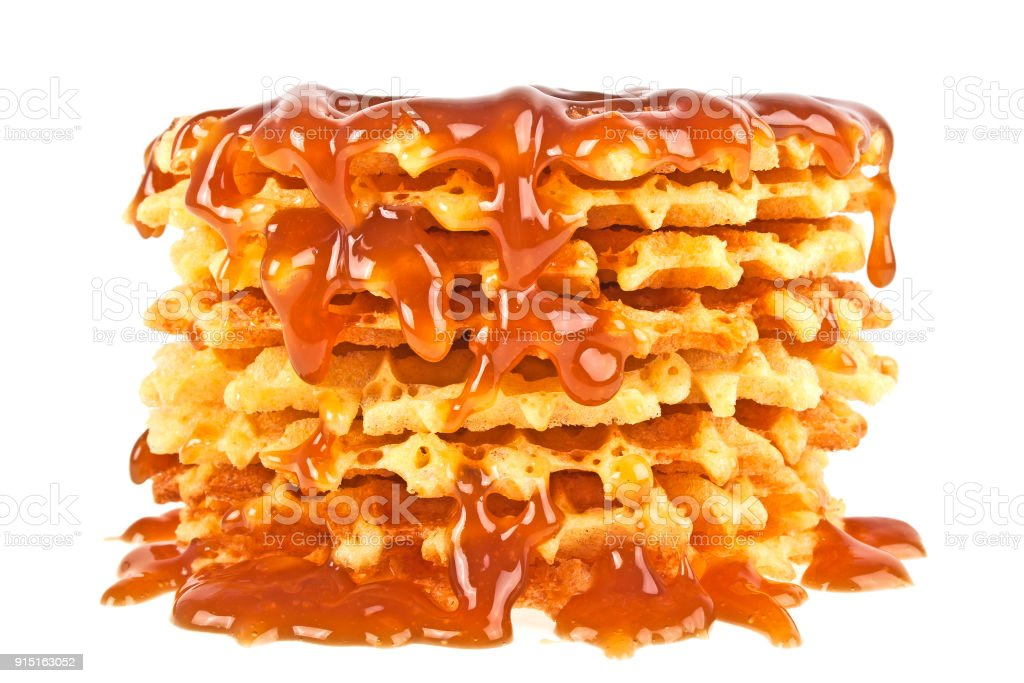 Waffles with caramel topping isolated on a white background stock photo